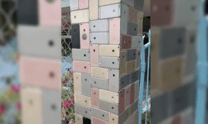 Dienas greznība: vjetnamietis uztaisījis žogu no veciem iPhone